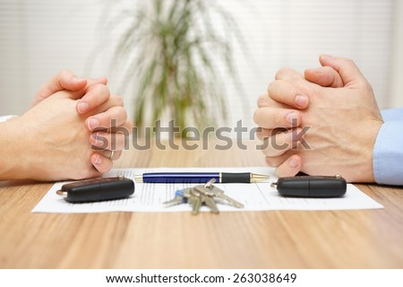 Divorce agreement. Wife and husband can not make settlement - stock photo