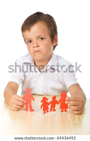 Divorce concept with sad kid holding separated paper people family - isolated - stock photo