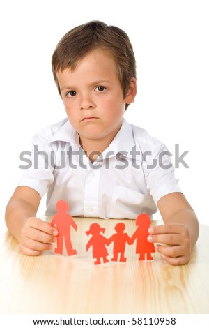 Divorce concept with sad kid holding splitted paper people family - stock photo