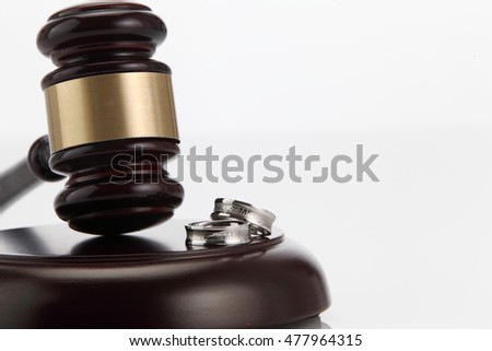 Divorce decree and wooden gavel on white background