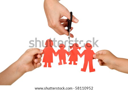 Divorce effect on kids concept with hands cutting paper people family - isolated - stock photo