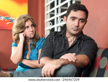 Divorce, marital problems - Sad husband and wife - stock photo