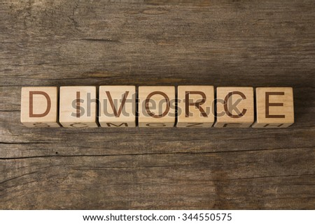 DIVORCE text on a wooden background