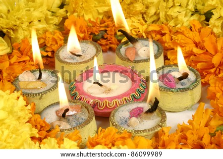 Diwali decoration, circle of lamps with flowers - stock photo