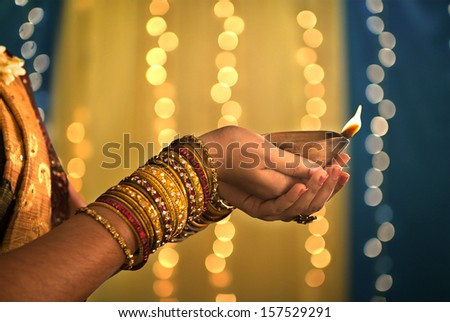 diwali festival of lights , hands holding indian oil lamp - stock photo
