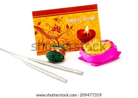 Diwali Greeting Card with Diwali Lamp, Sparklers, Rassi Bomb, firecrackers isolated on white background during Diwali festival India Asia South East Asia - stock photo
