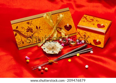 Diwali Greeting Card with firecrackers and hundred-rupee currency on red background during Diwali festival India Asia South East Asia - stock photo