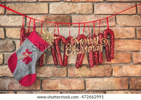 DIY Christmas decoration hanging against brick wall