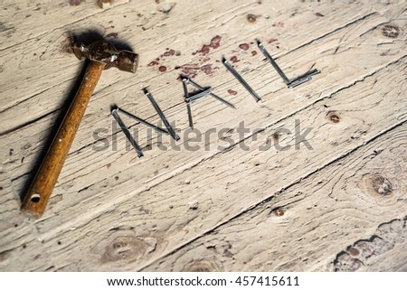 diy concept with Old vintage hammer and nails on rustic wooden background with copy space.