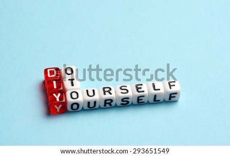 DIY Do It Yourself written on dices on blue background