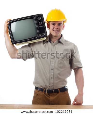 DIY Handy Man with TV television - stock photo