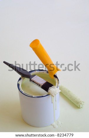DIY home improvement brush, roller and paint tin - stock photo