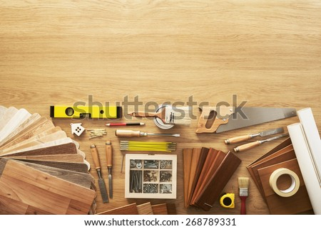 DIY workbench top view with carpentry and construction tools, copy space at top - stock photo