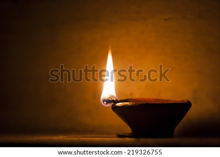 Diya lit up during diwali at home - stock photo