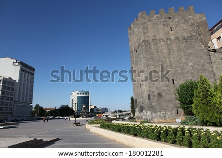 DIYARBAKIR, TURKEY - JUNE 30: Kurdish people walking around Diyarbakir's city wall on June 30, 2013, in Diyarbakir, Turkey. The 4-gated city wall are the second longest wall in the world. - stock photo