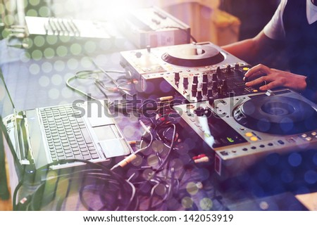 DJ and his equipment. - stock photo