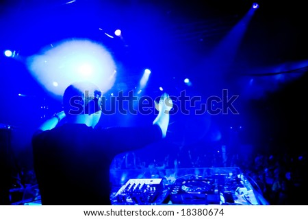Dj at the concert, blurred motion - stock photo