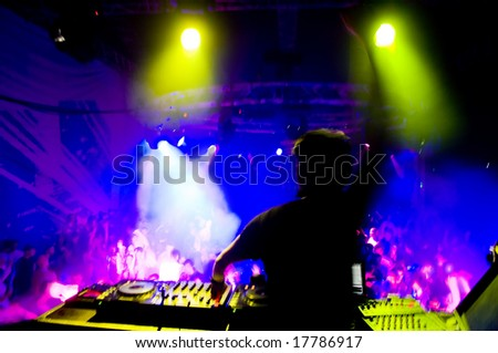 Dj at the concert, blurred motion, laser show and music