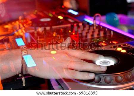 DJ at work, disco party - stock photo