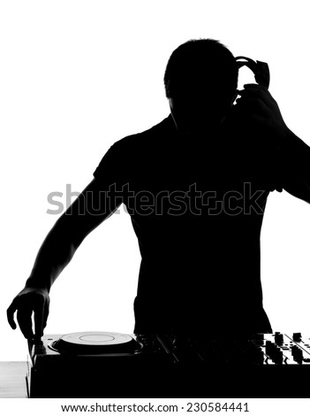 DJ at work. Happy young man is spinning on turntable while isolated on white. - stock photo