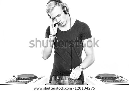DJ at work in front of white background - stock photo