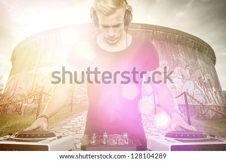 DJ at work with beautiful colors - stock photo