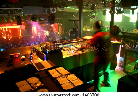 DJ at work. With blur caused by slow shutter speed. - stock photo