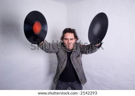 DJ balancing two vinyl records - stock photo