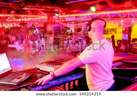 DJ behind the control panel vinyl records