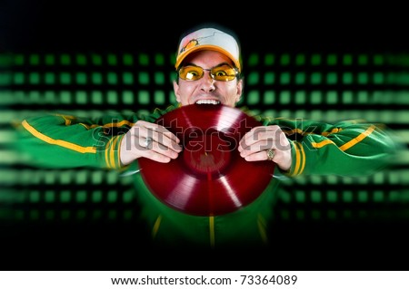 DJ Biting Record blending into lights in the background - stock photo