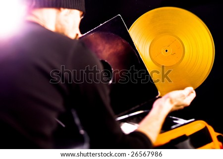 DJ choose golden vintage vinyl - stock photo