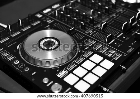 DJ console cd mp4 deejay mixing desk music party in nightclub. Black and white image. select focus - stock photo