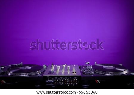 dj equipment on violet background - stock photo