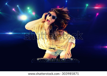 Dj girl dancing with light on background