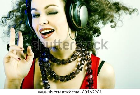 DJ girl listening music in headphones - stock photo