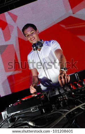 Dj in action, playing disco house music - stock photo