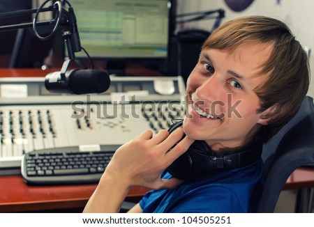 Dj in front of a microphone on the radio - stock photo
