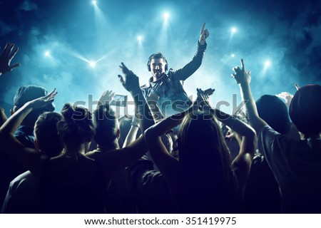 Dj in front of crowd - stock photo