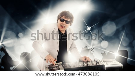 DJ is playing music with an open mouth