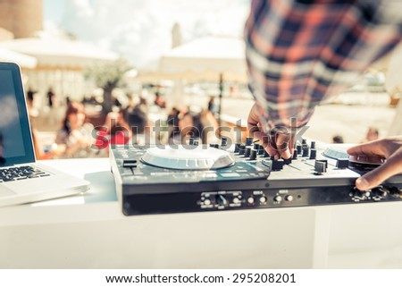 dj mixer close up while he is mixing. concept about party, music, fun and people - stock photo