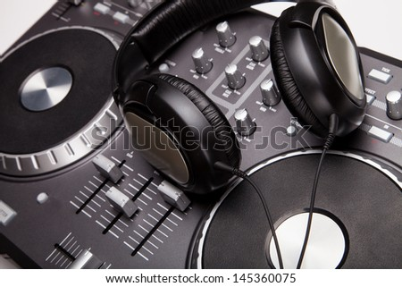 Dj mixer with headphones - stock photo