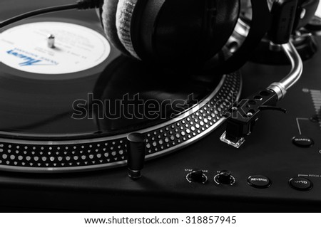 Dj mixer with headphones at nightclub. Musical instrument.