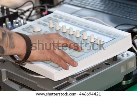 DJ mixes on equipment - stock photo