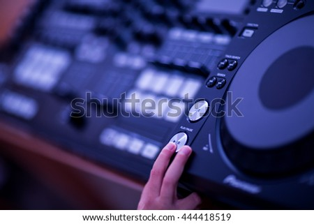 DJ mixing music on console at the club  - stock photo