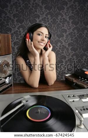 Dj retro woman vintage vinyl turntable music open reel tape recorder - stock photo