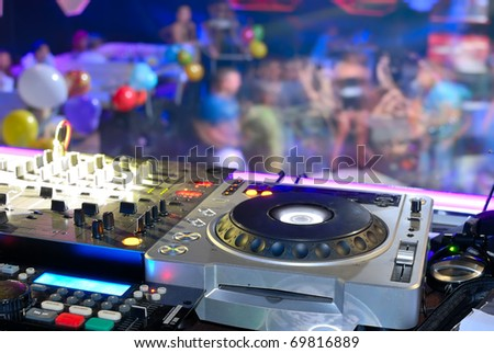 DJ's deck other the dancefloor, disco patry - stock photo