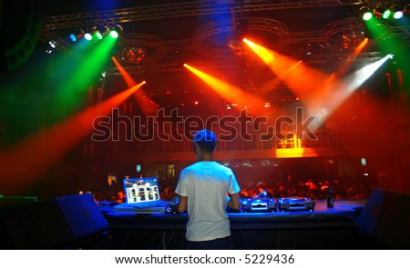 DJ spinning at a club