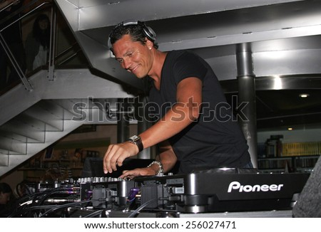 DJ Tiesto, the world's number 1 trance deejay spins his set and meets his fans held at the Virgin Megastore in West Hollywood, California, United States on August 10, 2007. - stock photo