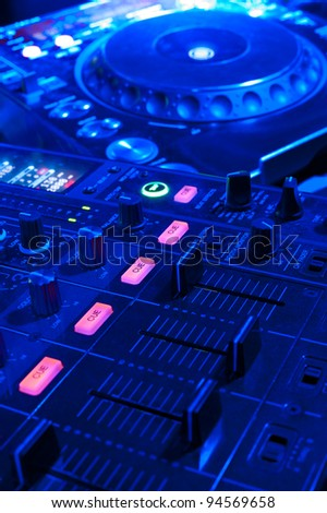 dj tools - audio control console and spin table - stock photo