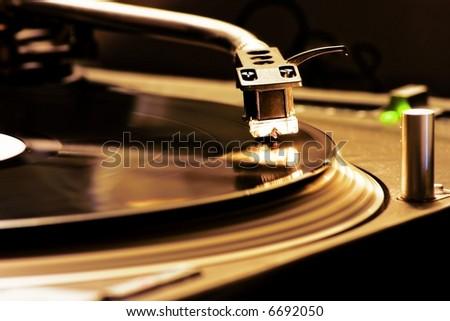 DJ Turntable. Closeup of a Dj turntable player - stock photo